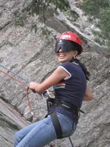 Student rock climbing while attending summer youth program.
