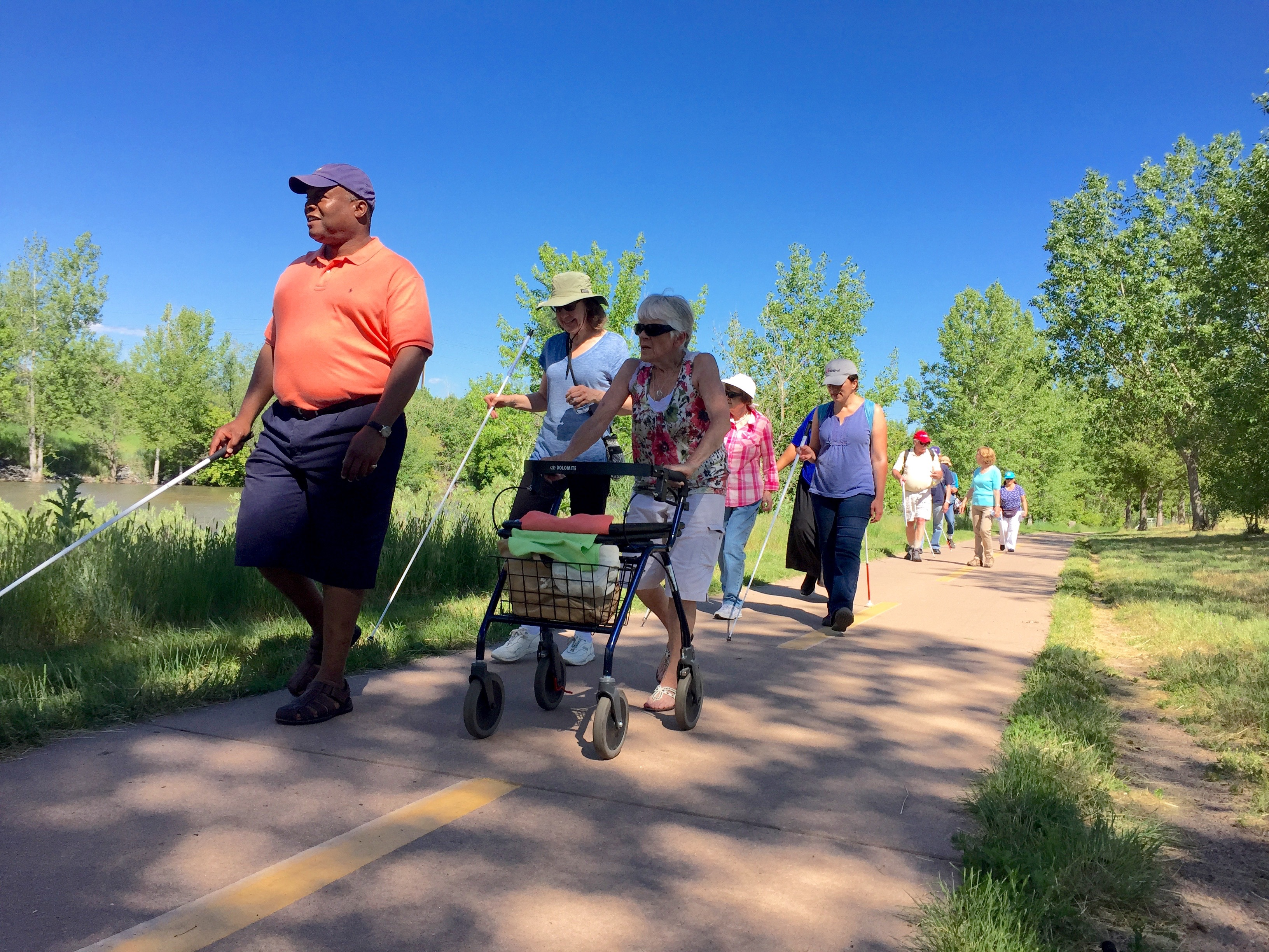 Group of Seniors Hiking along the High Line Canal Trail to the Platt River