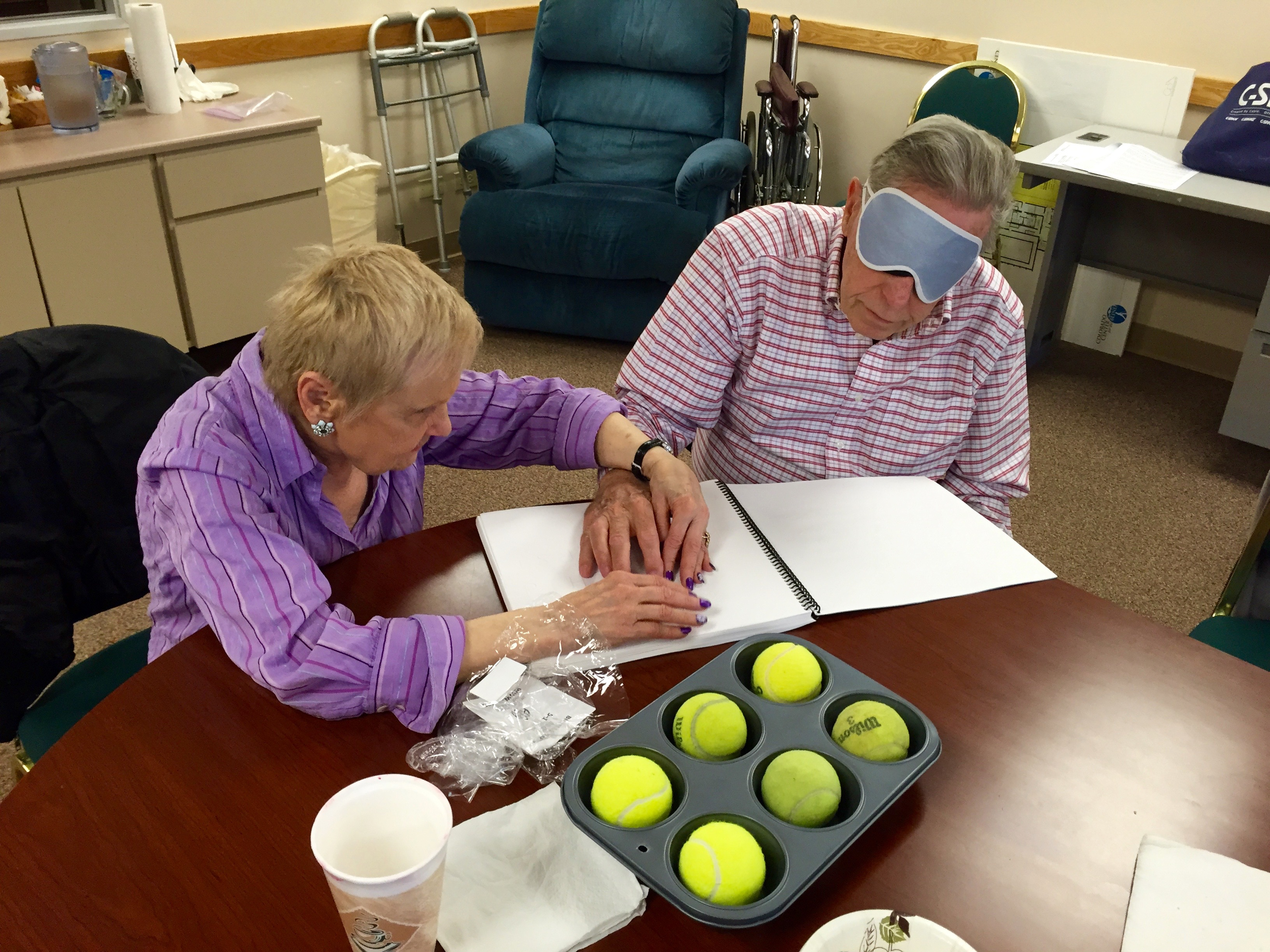 "Senior getting ""hands on"" Braille Instruction"