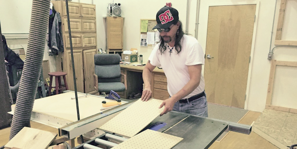 Student makes a cut on the table saw