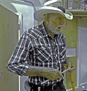 A man runs fingertips along a a notched aluminum tue