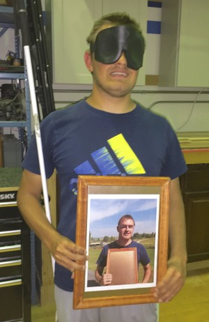 Picture frame shows a photo of Andy holding his picture frame