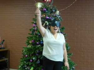 young woman rings her bell with a smile