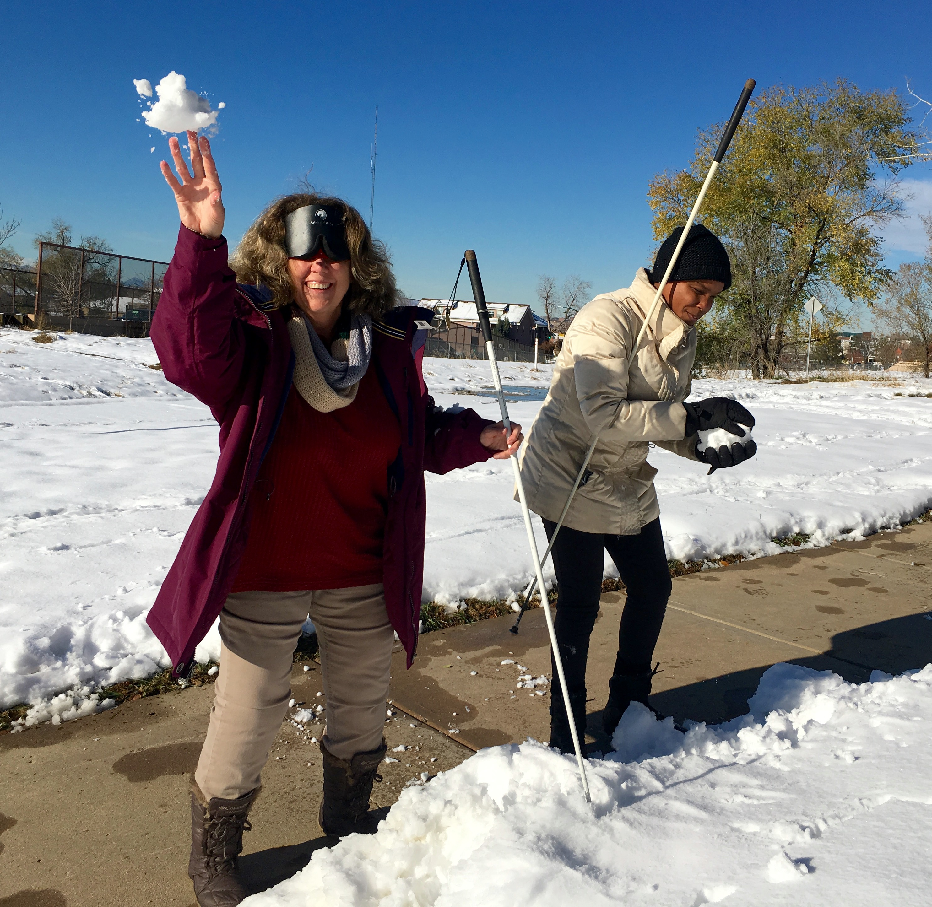 Vicki and Mo making and throwing snowballs A snowball is flying out of Vicki's hand right toward us