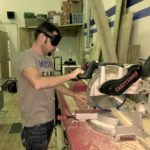 Markus makes a cut on the chop saw