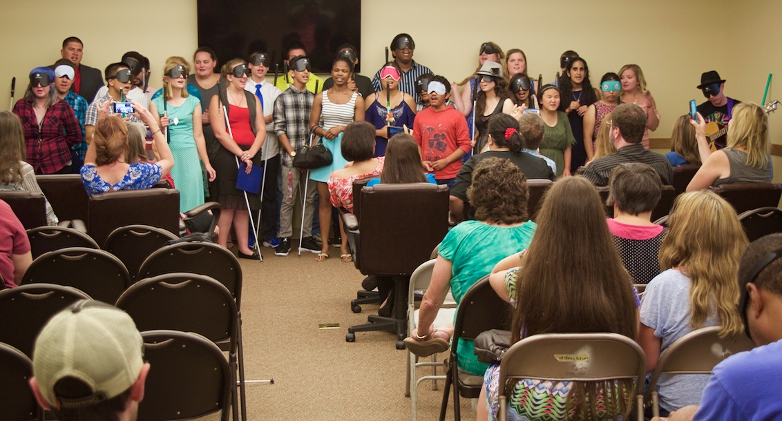 Students and counselors lined up in choir fashion singing