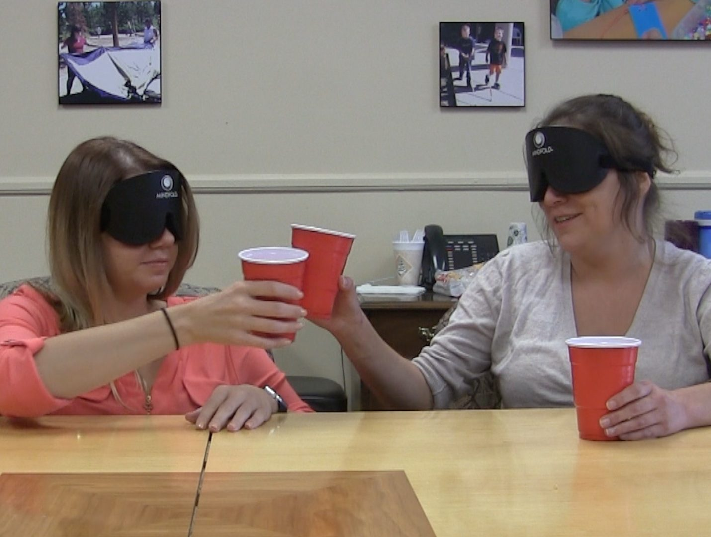 Two women touch glasses