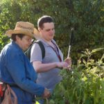 Master Gardener shows new student (David) around the garden