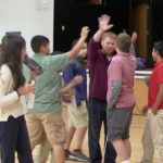 Ryan High-Fives with the students after shooting some hoops