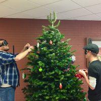Perez and Jackson decorating the tree