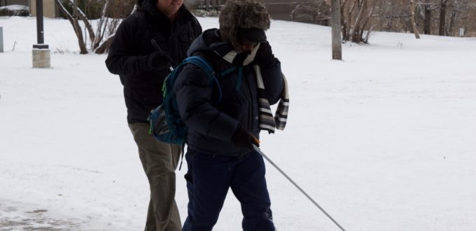 Martin and Lynne walking in the snow. You can see the steam from Martin's breathing