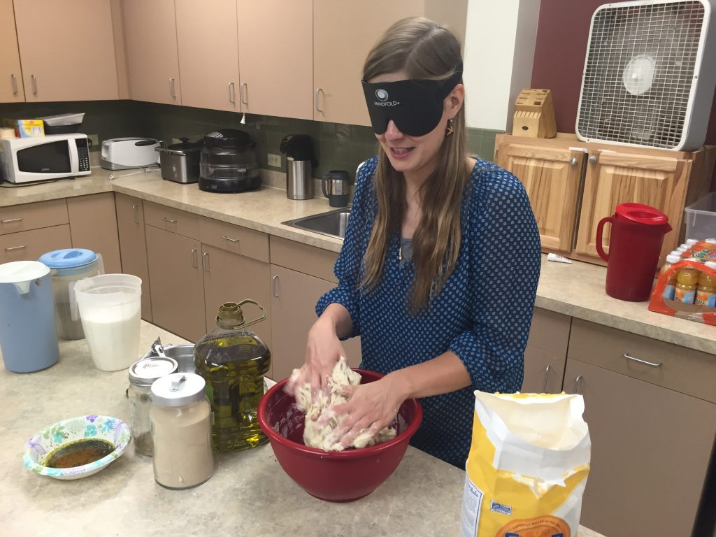 Tabea kneads dough with both hands