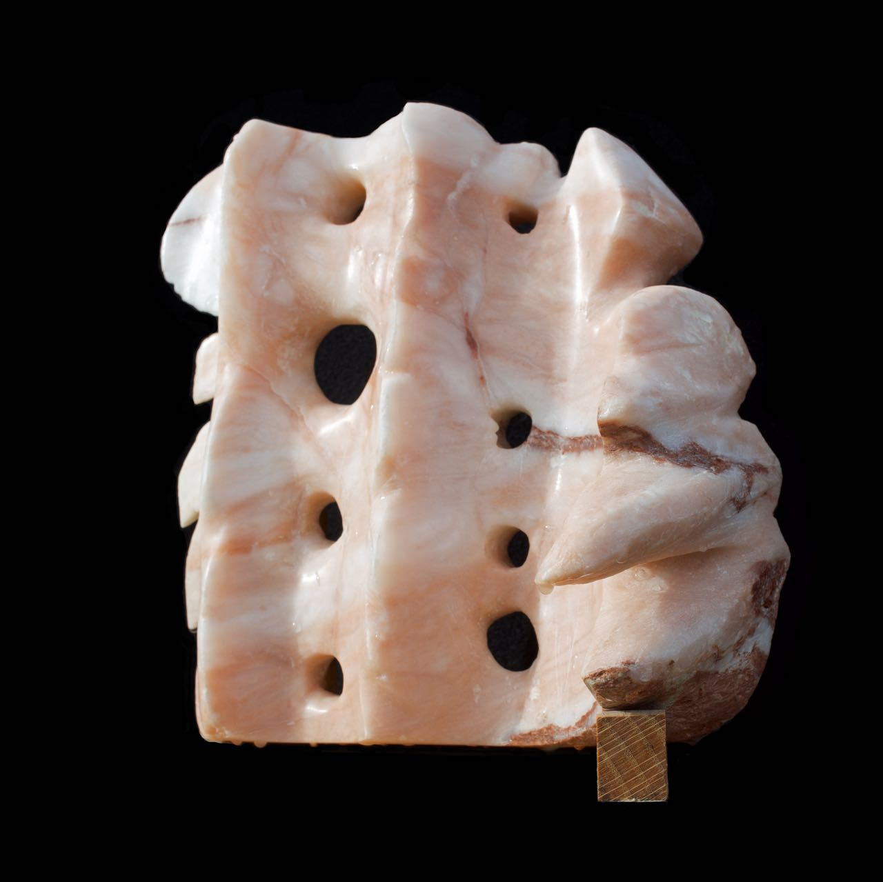 An alabaster sculpture with flowing and spiky elements