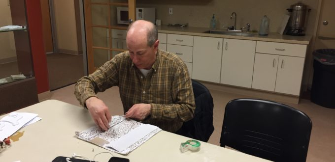 Peter exploring the paper's textures with his fingers