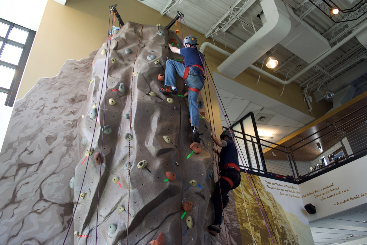 Dugan and Charles both near the top of the climbing wall