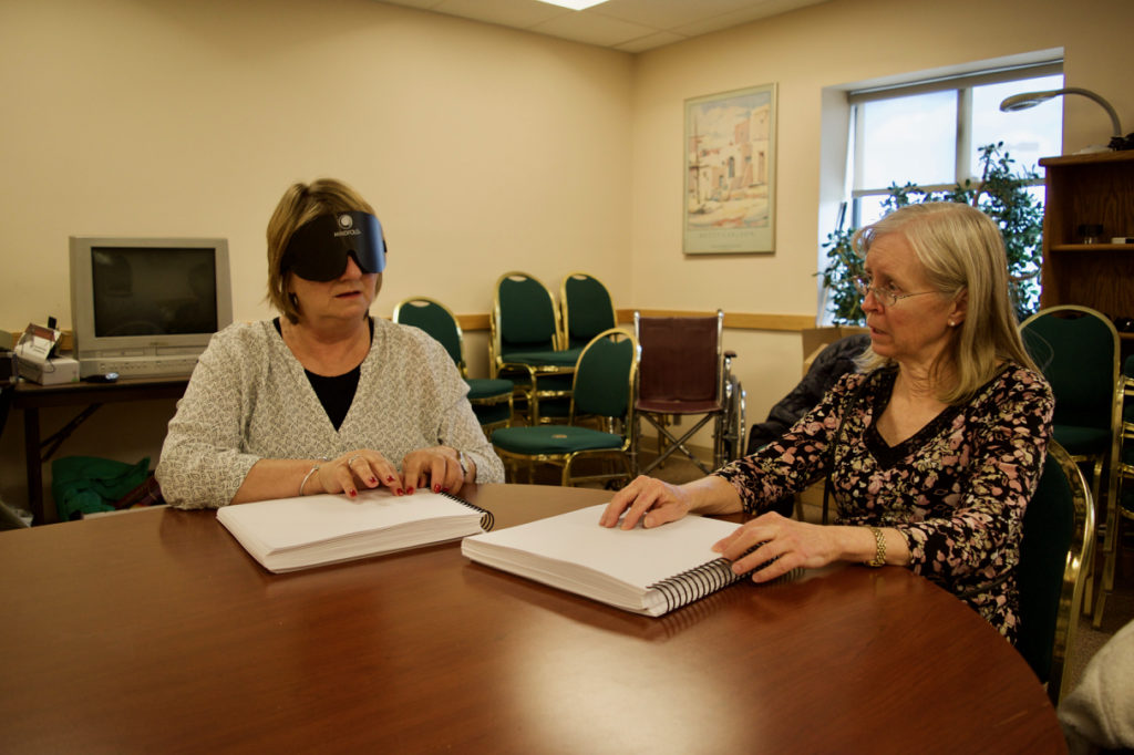 Holly and Janet reading Braille Books