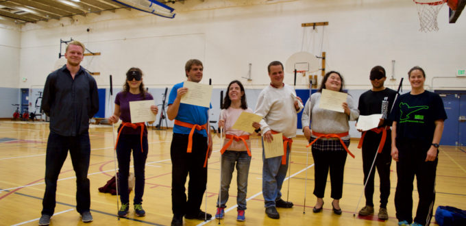 Martial Arts group - Orange Belts and Certificates - Travis, Ceci, Mike, Serena, David, Showe, Chaz and Rachael