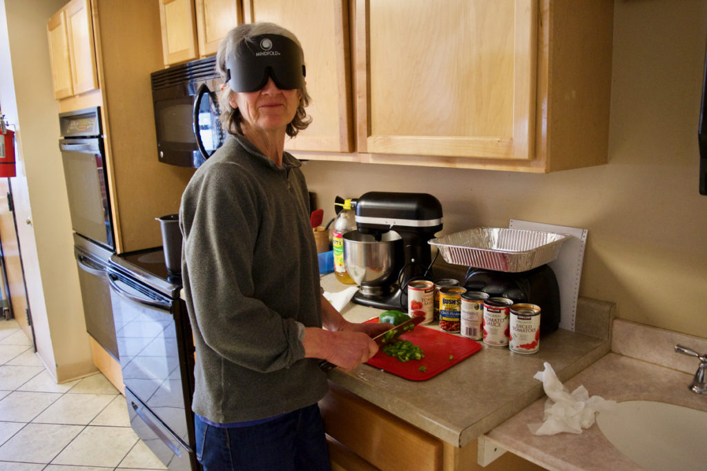 Sally wears sleepshades while chopping Bell Peppers