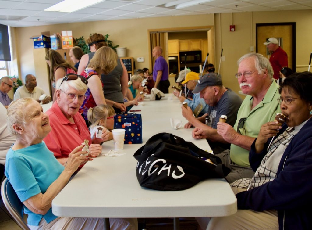 Diane witha group of seniors enjoying ice cream