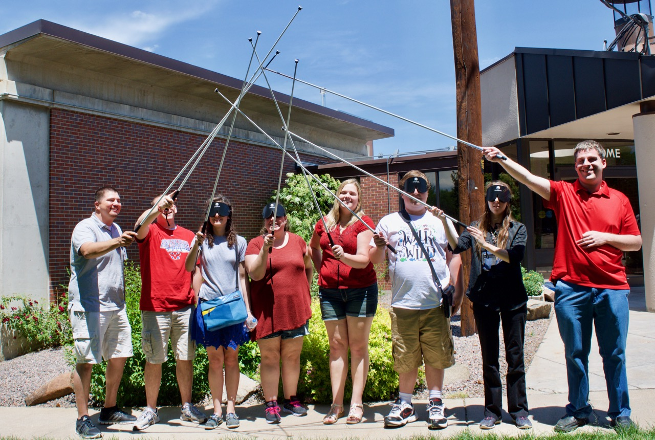 Summer staff with canes crossed in the air