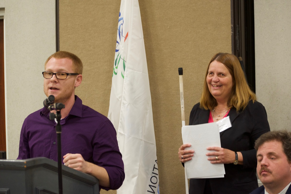 Ryan at the podium with Julie and Scott to the right at NFBCO17