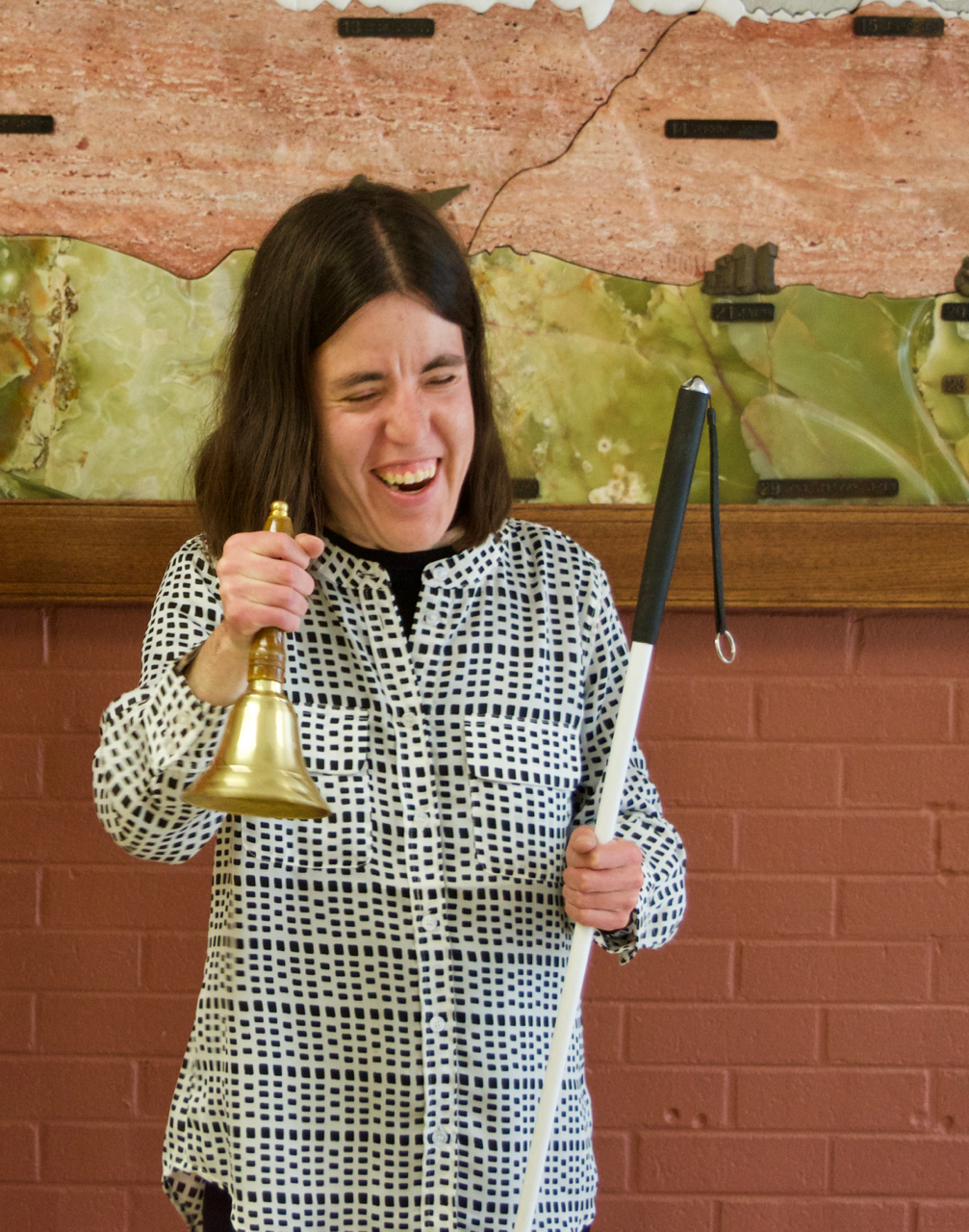 Serena ringing her Freedom Bell at her graduation