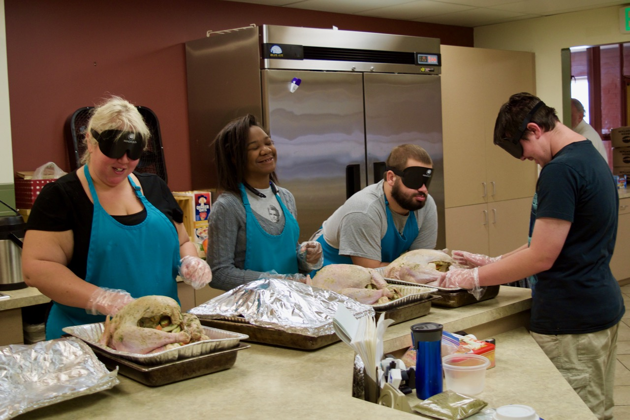Lia, Ravi, Mason S. and Mason M. prepare four large turkeys to go into the ovens