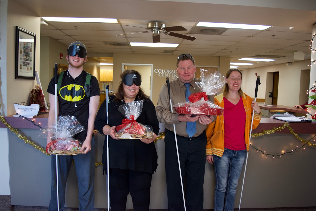 Casey, Mickey, Brent and Holly in the CCB lobby holding trays of cookies to be delivered to our City Offices
