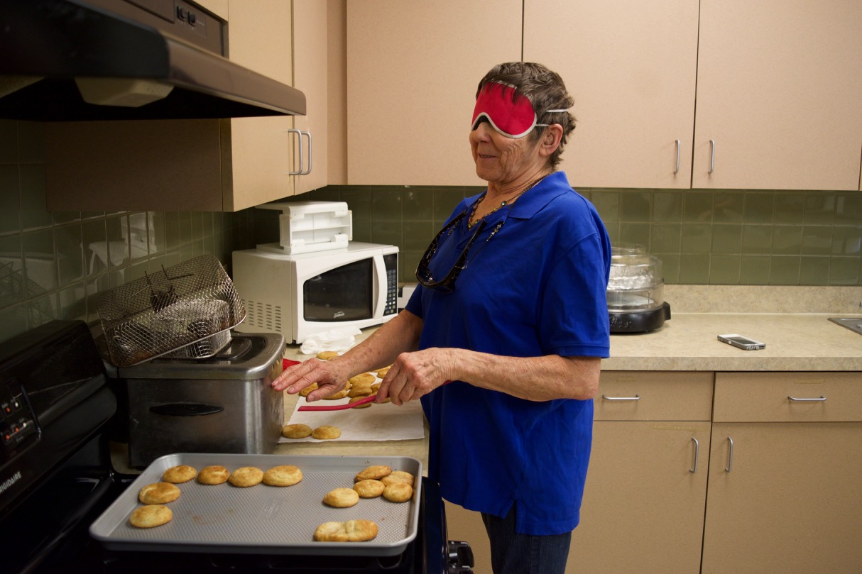 Dee works with trays of home made cookies hot out of the oven
