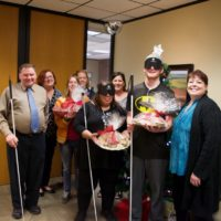 Delivering plates of cookies, Brent, Holly, Mickey and Casey are pictured with members of the City Manager's staff