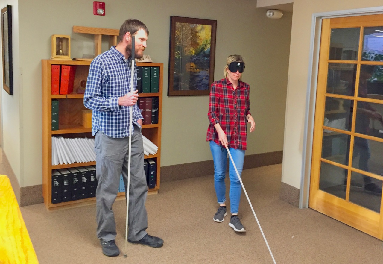 Kirsten with David working on cane travel in the front lobby