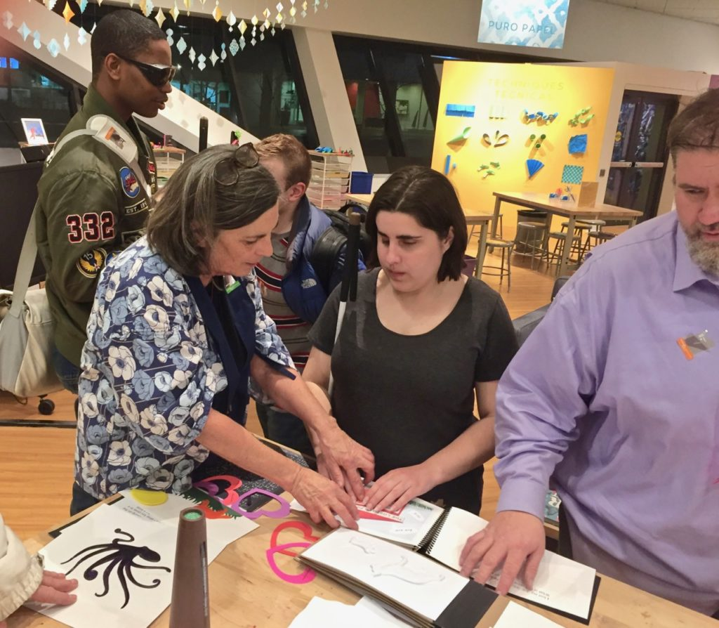 Ann explores tactile art with a group of blind students at the Denver Art Museum