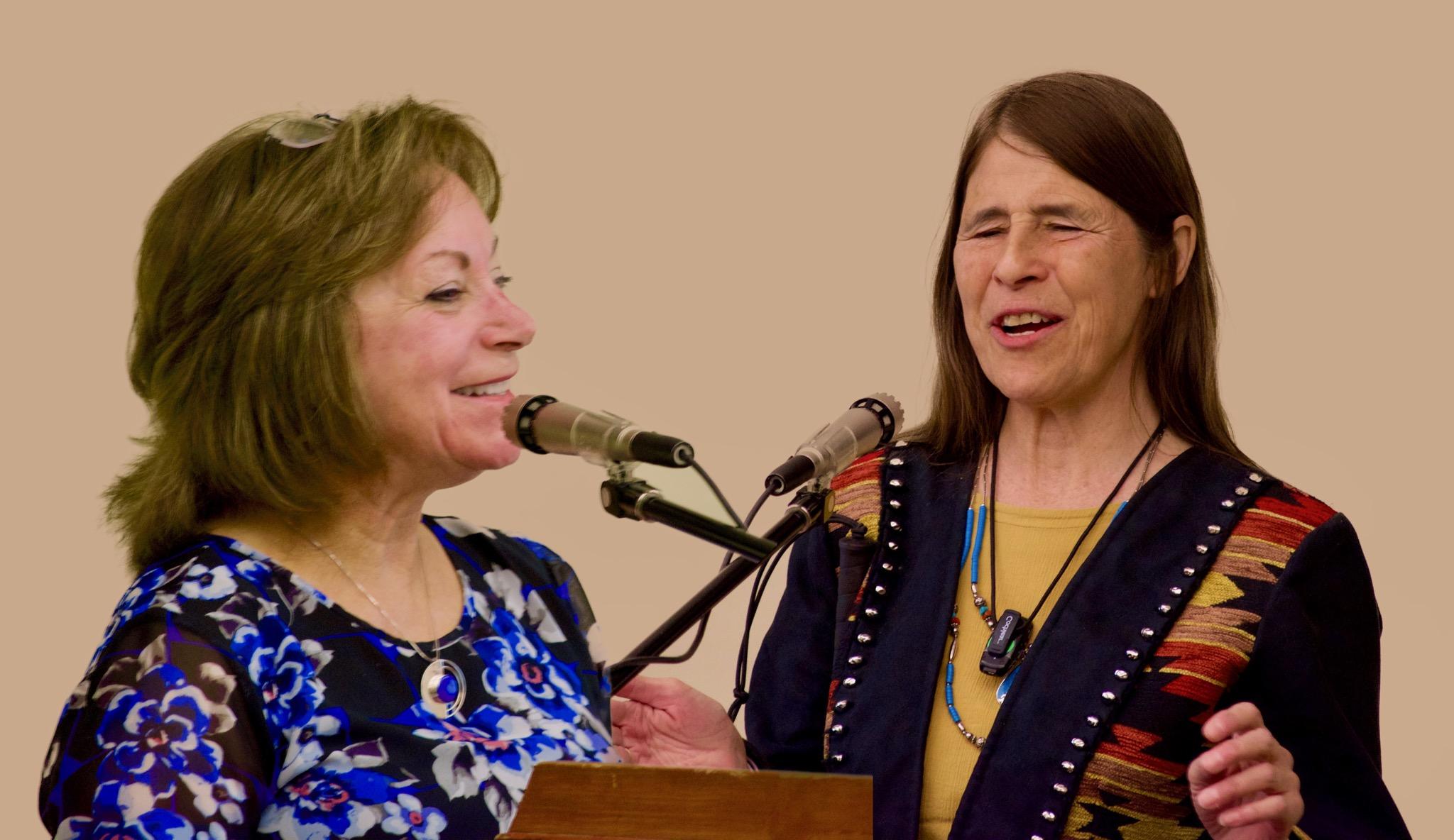 Dianne Primavera and Judy Mares-Dixon at the podium