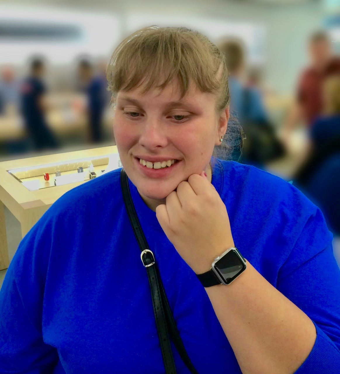 Grinning, Megan shows the Apple watch on her wrist to the camera