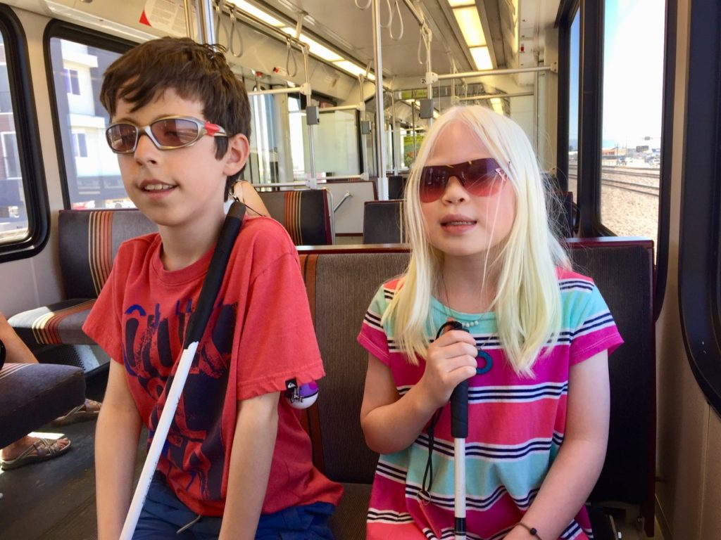 Ty and Chloe ride the Light Rail