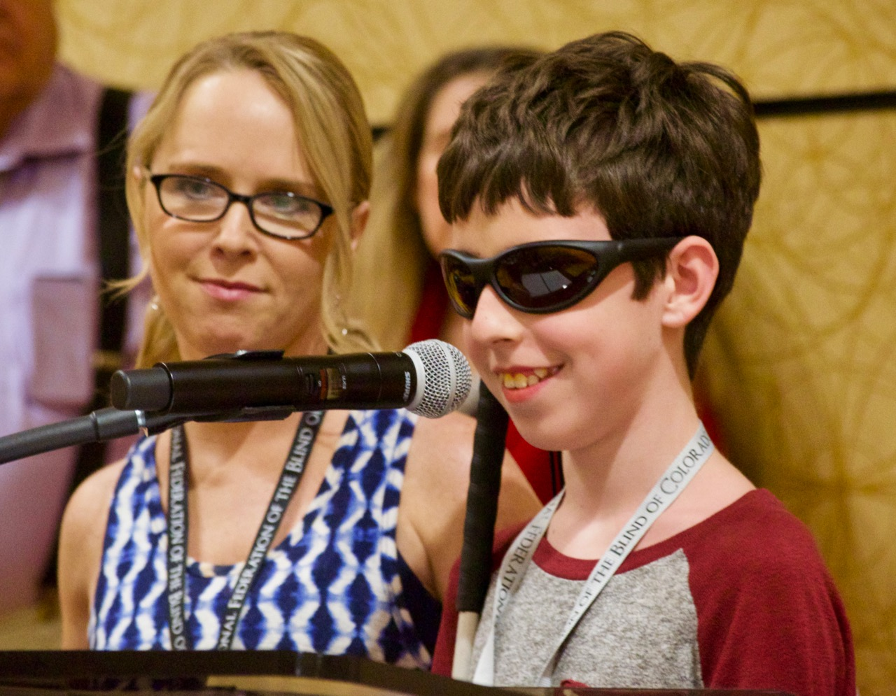 Ty and his mom at the podium at NFBCO18