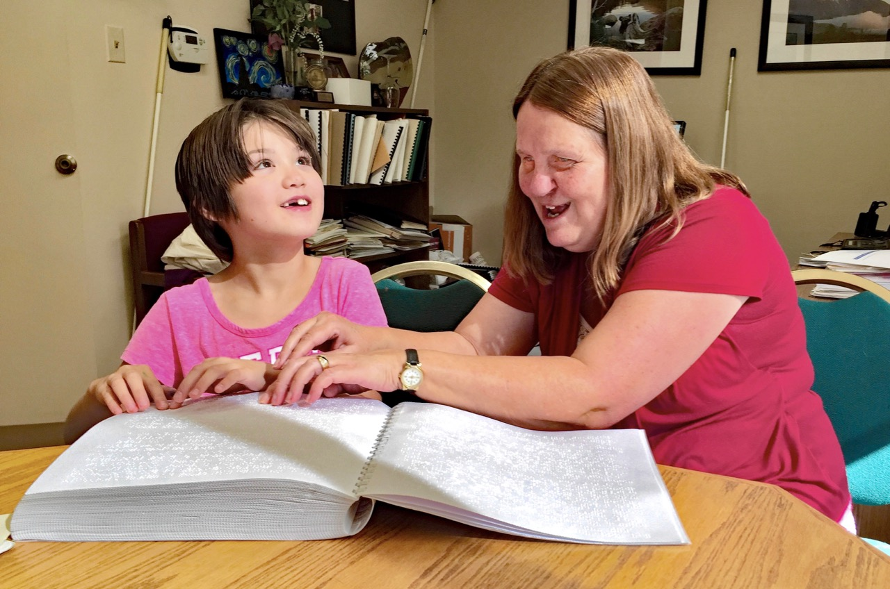 Julie and Lexi Reading Braille