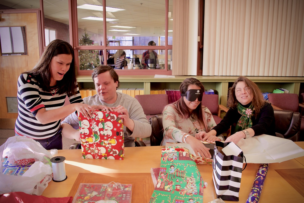 Stephannie, Brett, Myra and Delfina wrapping final gifts