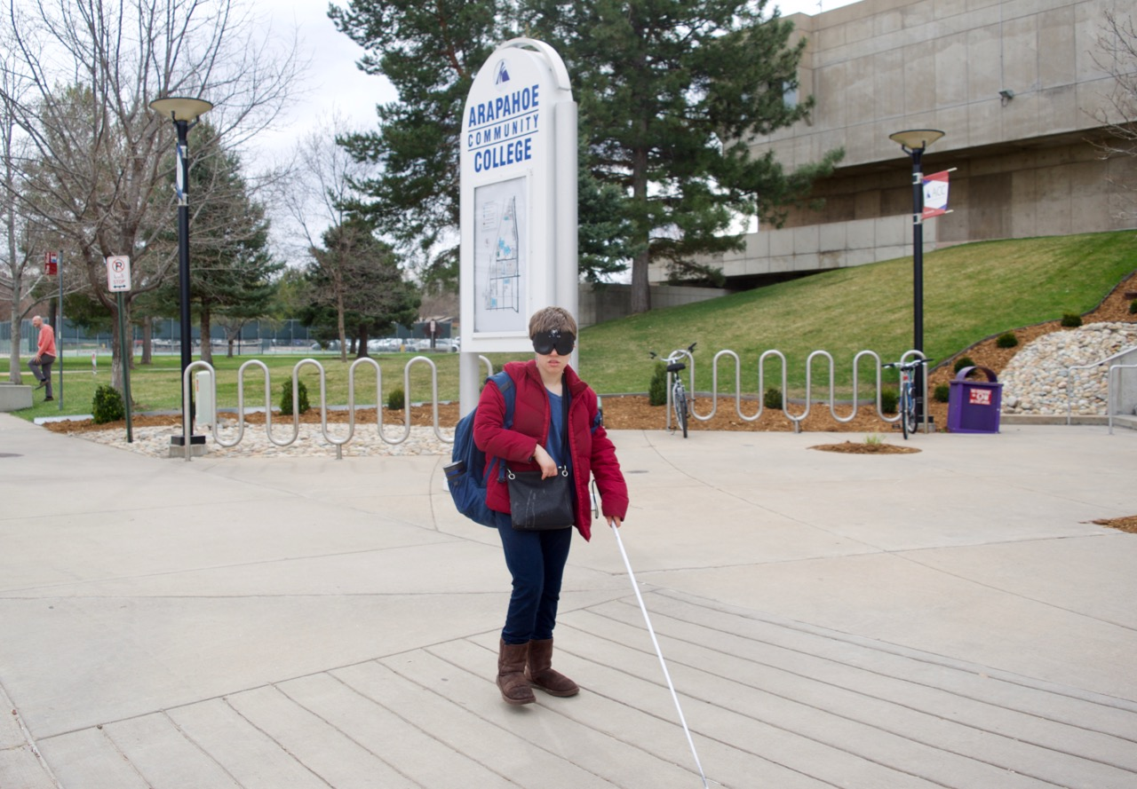 Mikayla walking in front of the ACC Main Building