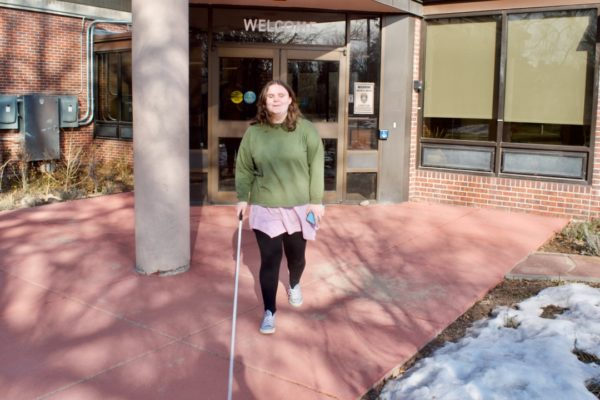 Holly headed out from the Center with her cane