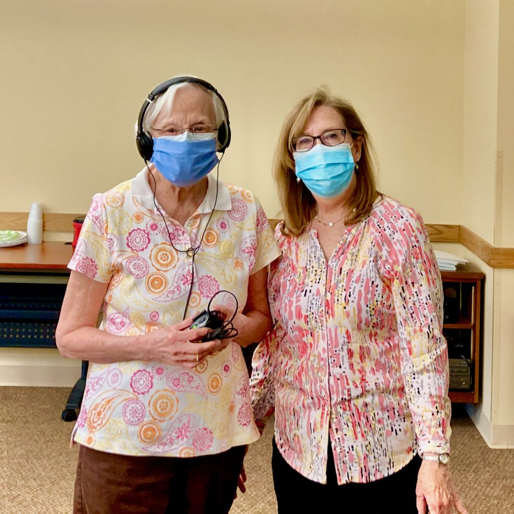 Two women in face masks