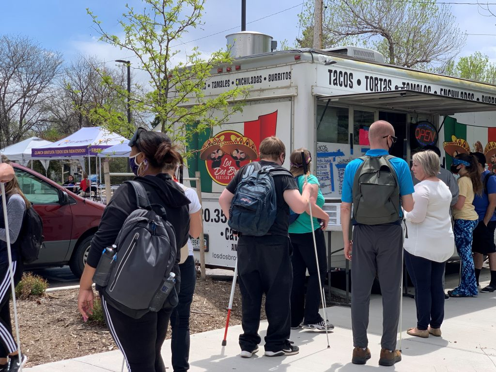 Students around the taco truck on Vax Day